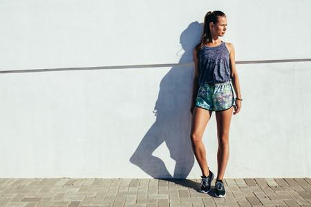 Female runner standing outdoors