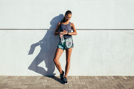 Female runner checking fitness progress