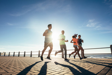 Runners training outdoors by the seaside