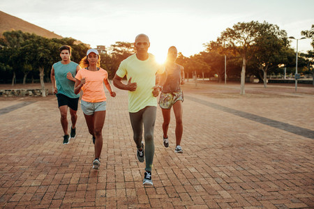 Group running outdoors in evening