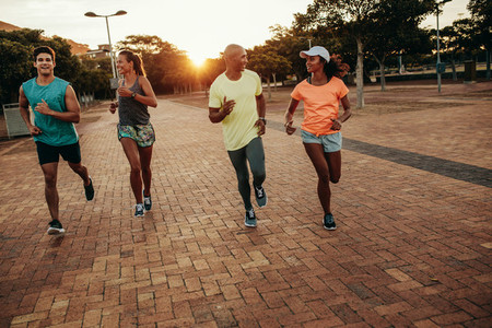 Runners training outdoors in evening