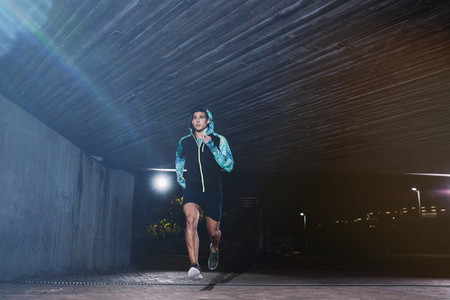Young man jogging at night