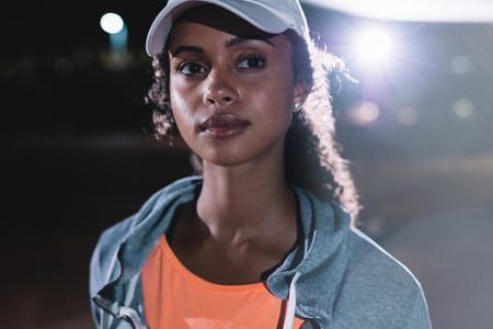 Fitness woman in city at night
