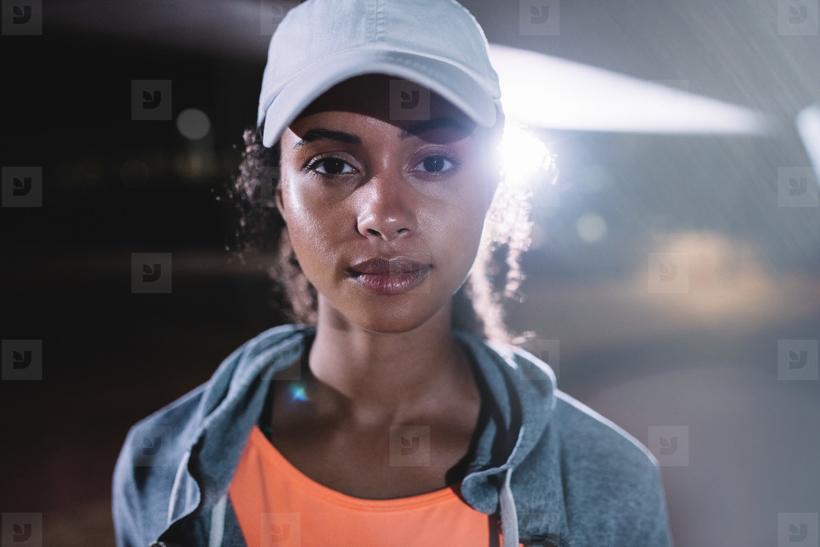 Urban female runner in city at night