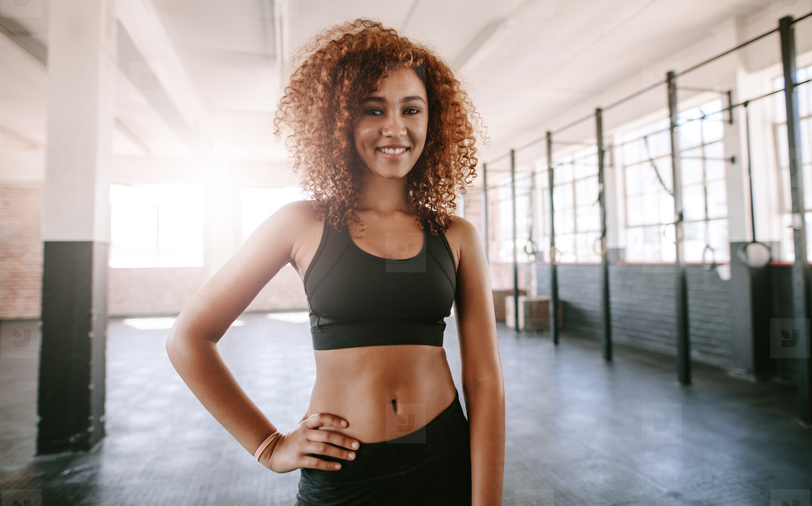Beautiful young african woman in gym