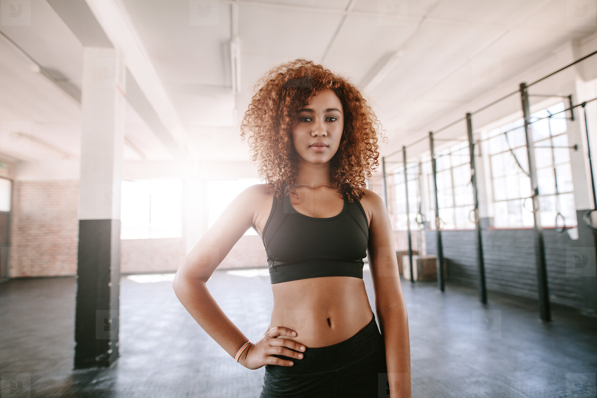Determined african female standing in the gym