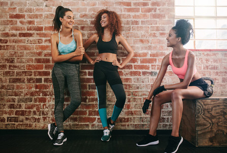 Female friends taking rest after fitness workout
