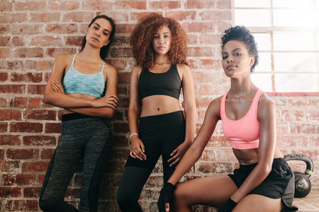 Three young female in gym