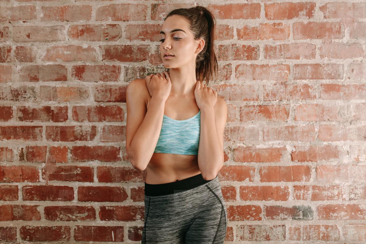 Female fitness model in gym