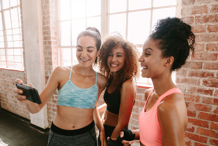 Female friends taking a selfie after fitness training