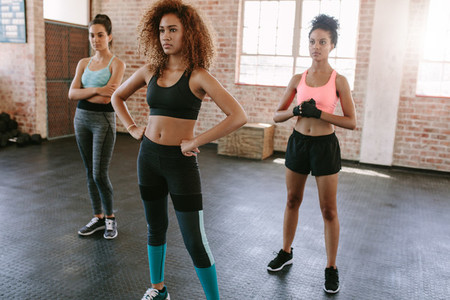 Three young woman at fitness class in gym