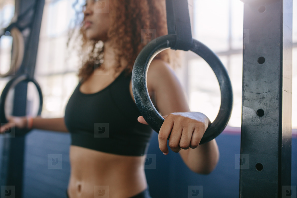 Woman exercising on gymnastic rings