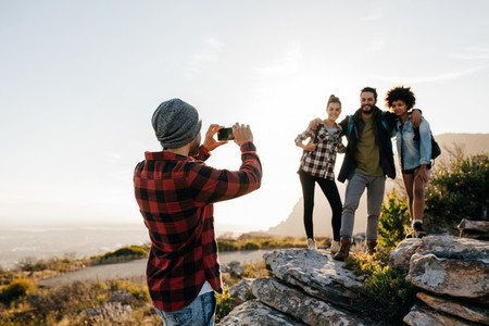 Group of people on hiking taking photographs