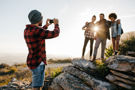 Friends on hike taking picture by smartphone