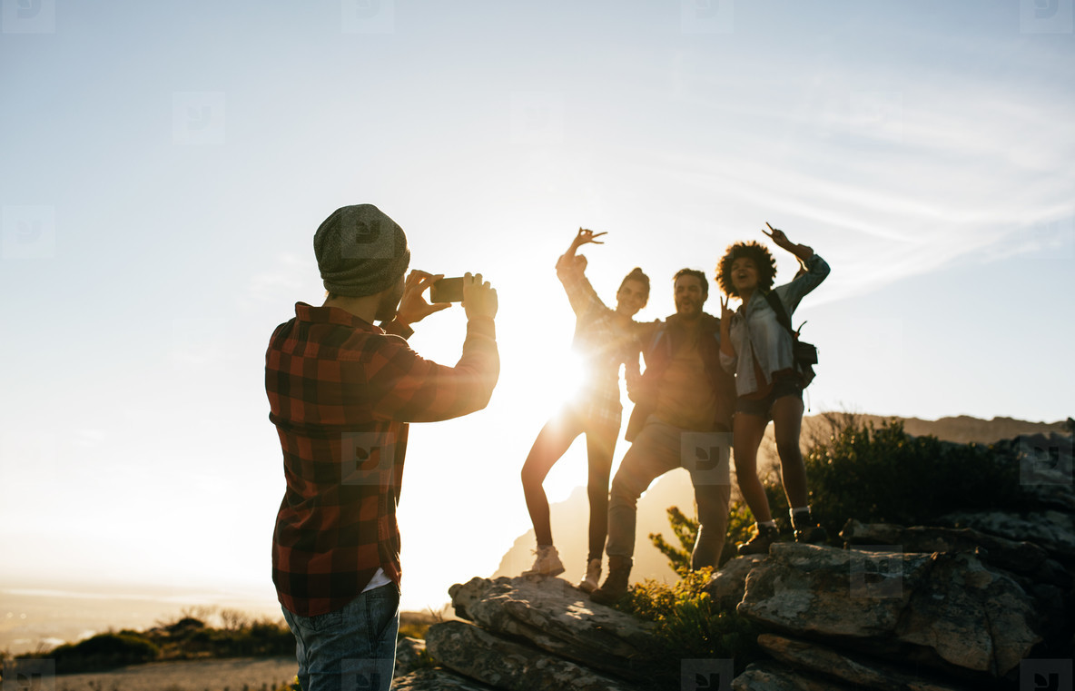 Group of young friends hiking on mountain