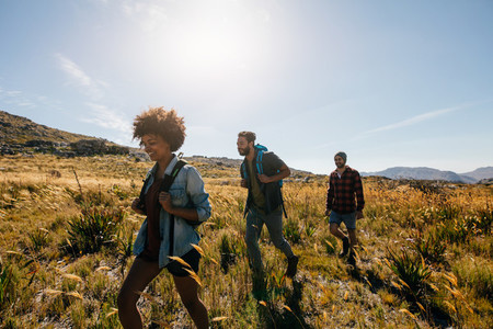 Group of people on walk through countryside