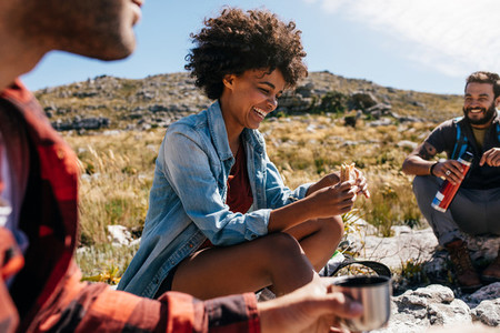 Woman with friends taking a break during hike