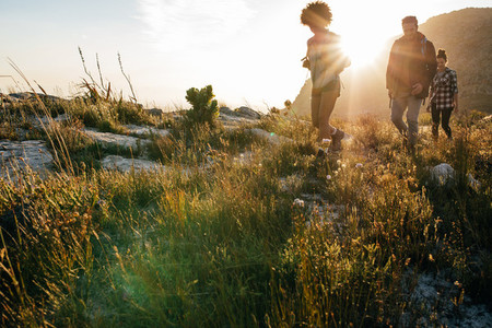 Young men and women hiking in countryside