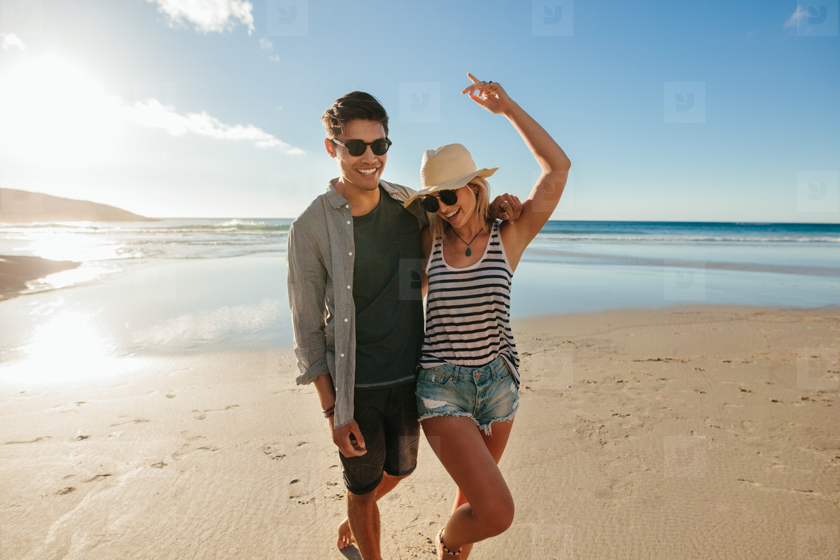 Young couple in love enjoying on the beach