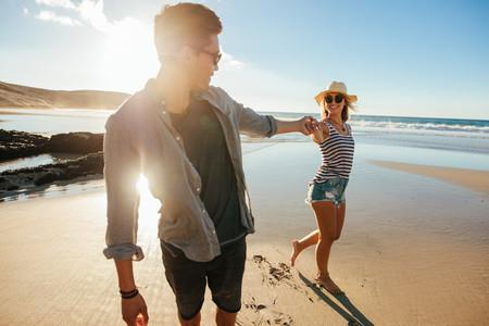 Loving young couple enjoying on beach vacation