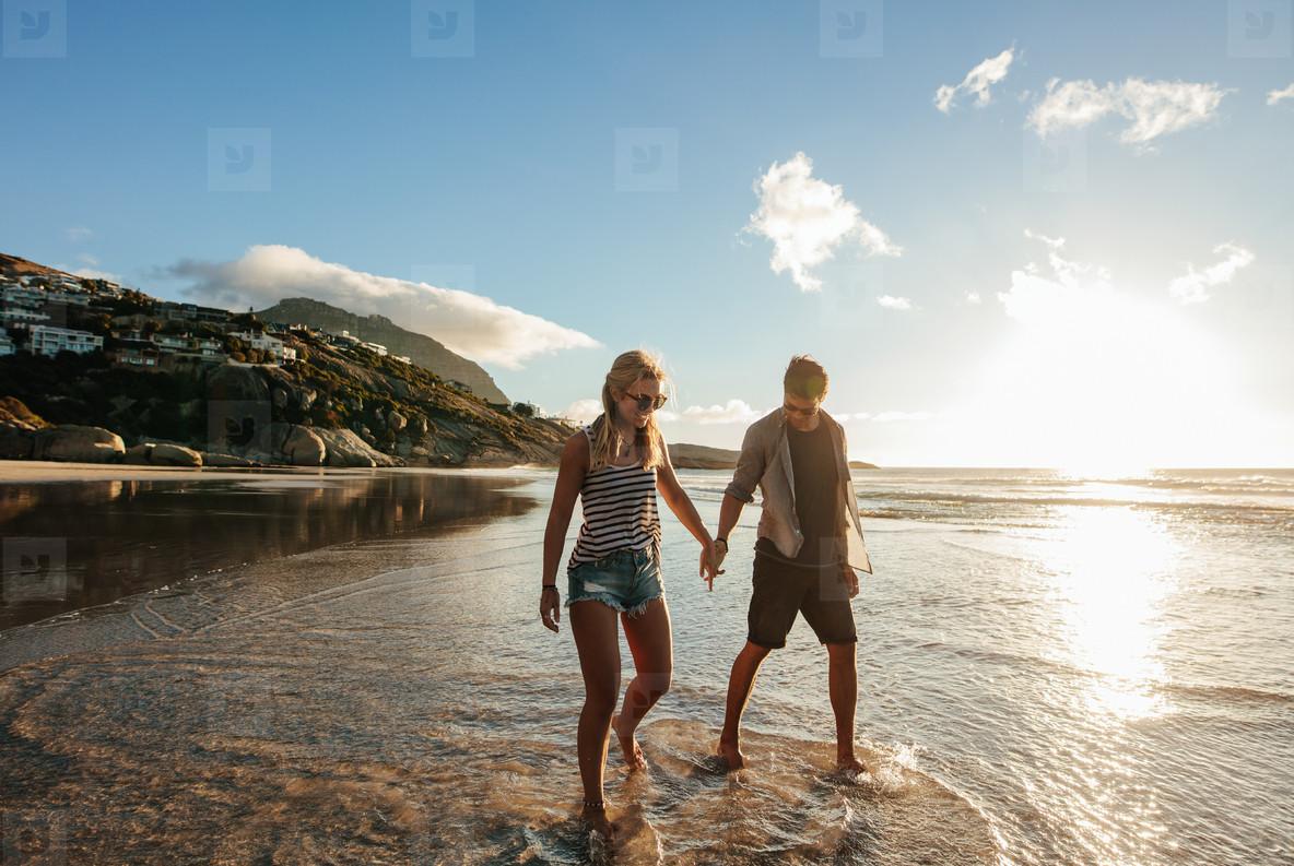 Happy young couple enjoying beach holidays
