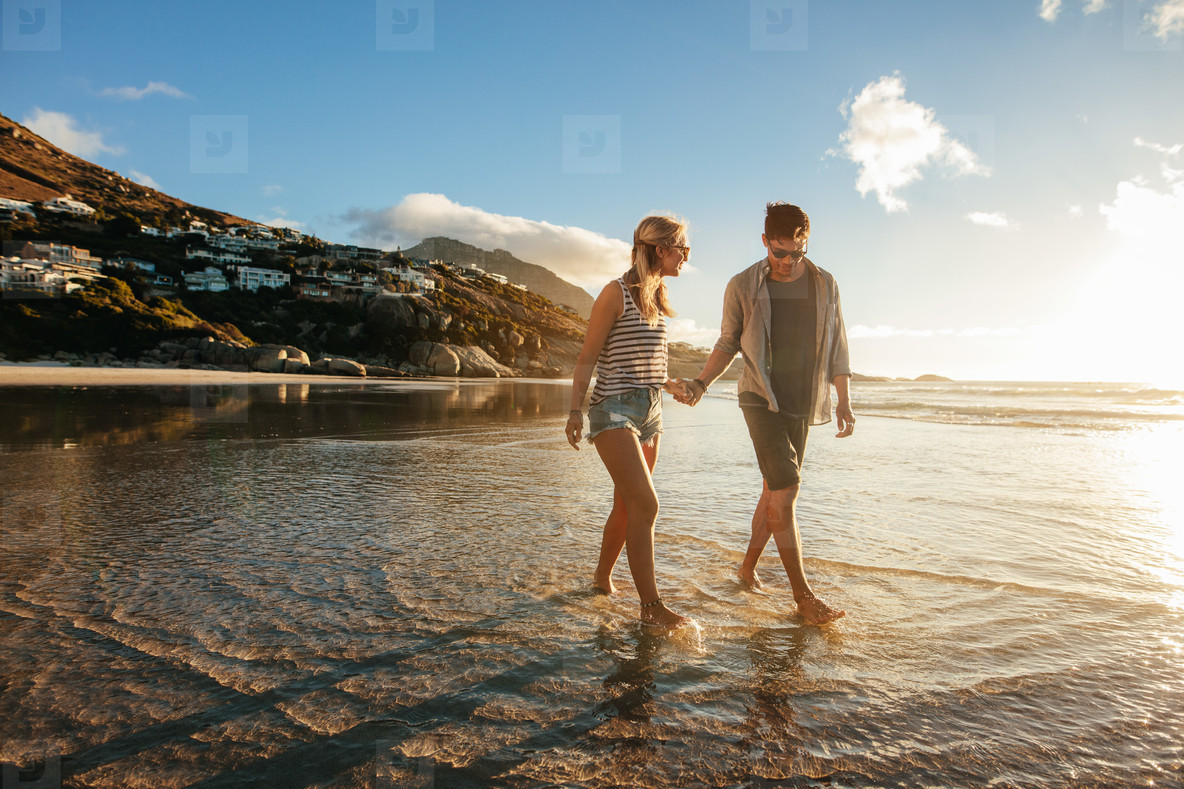 Young couple  strolling on the sea shore