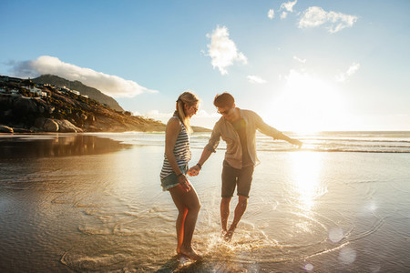 Beautiful young couple having fun on beach