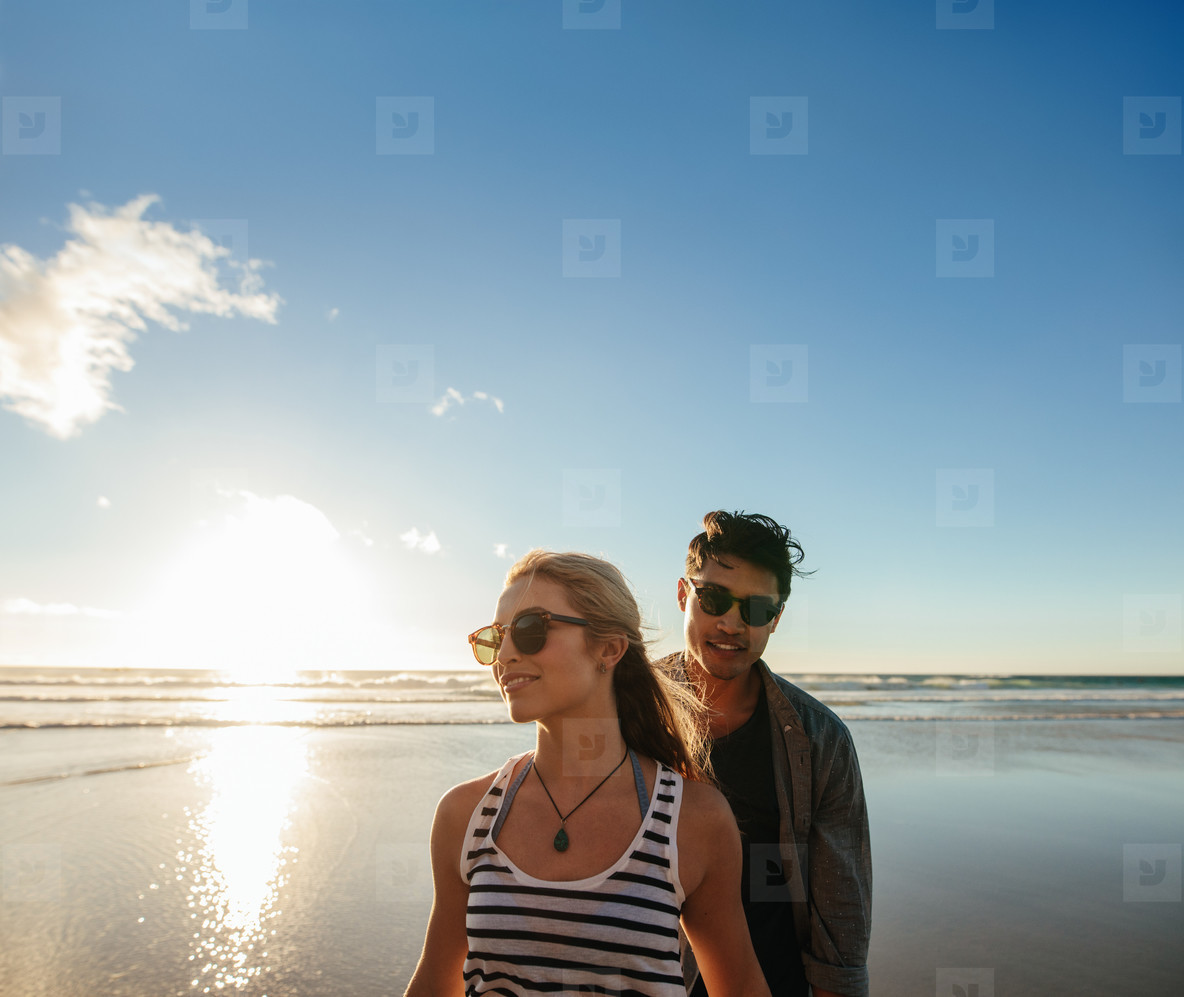 Young couple on the sea shore