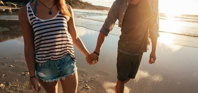 Couple strolling on sea shore