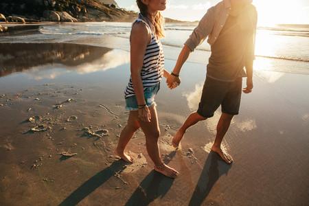 Loving couple walking on sea shore