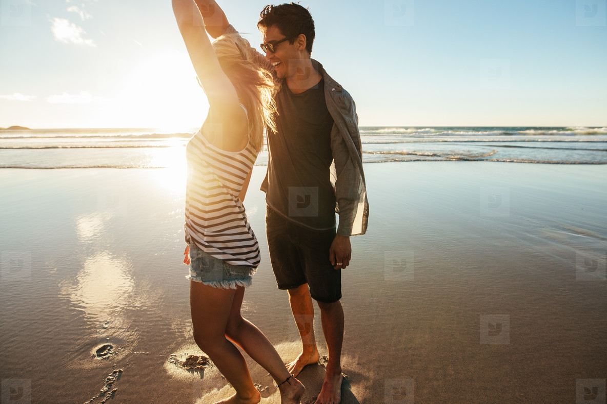Loving couple dancing on the shore