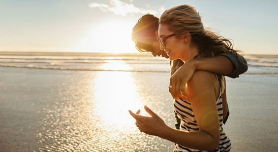 loving young couple enjoying a day on beach