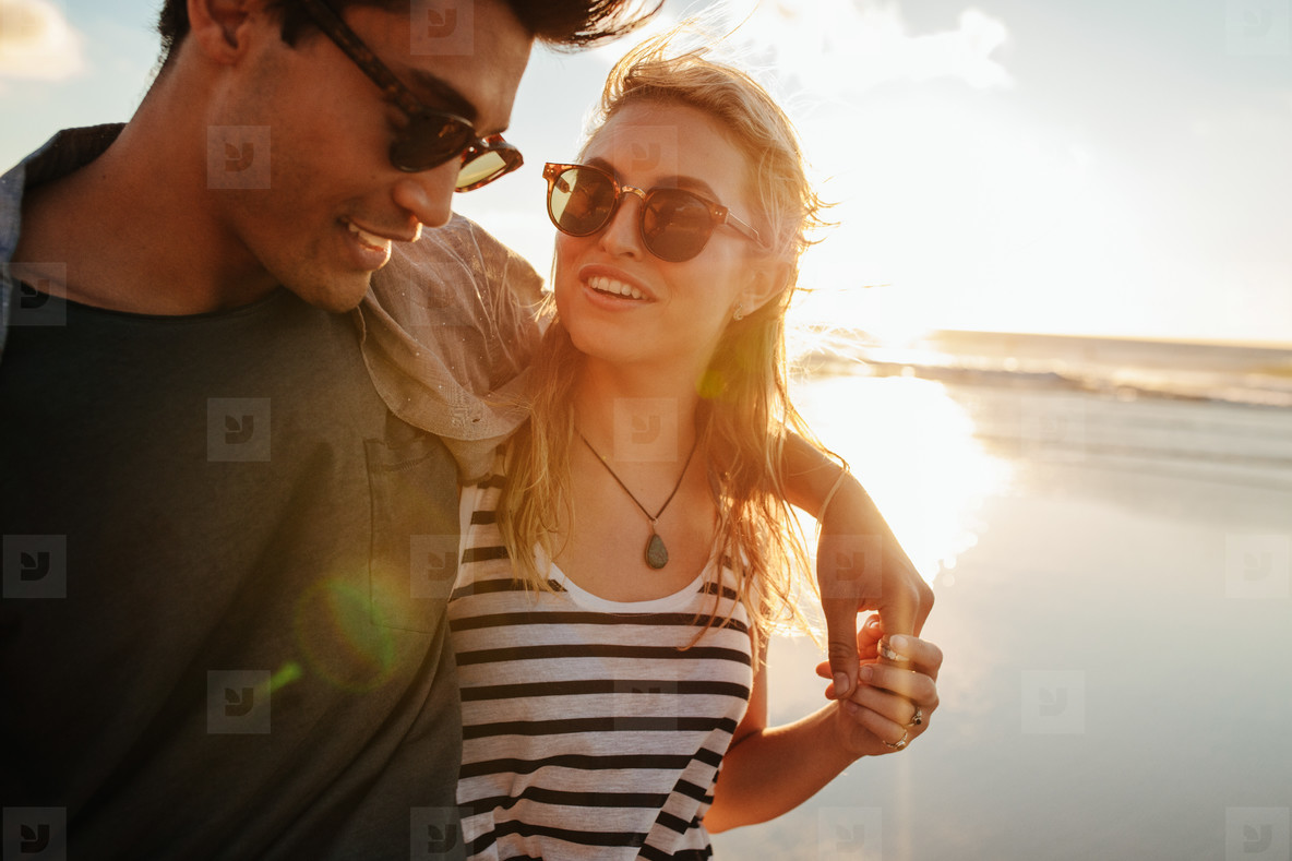 Beautiful woman with her boyfriend on the beach