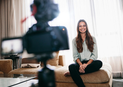 Female blogger recording video content for her blog