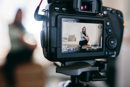 Closeup of a DSLR camera recording a video blog
