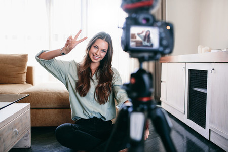 Young woman recording content for her blog