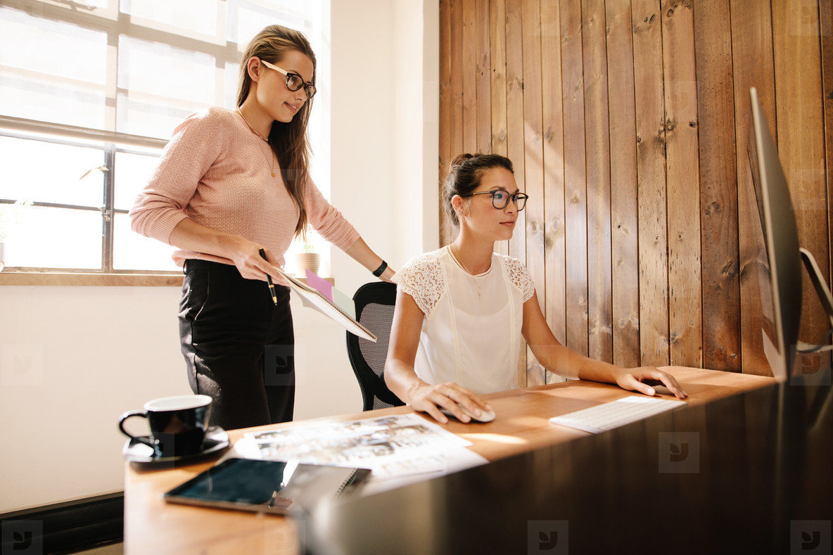 Creative business women at the office desk