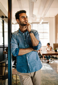 Thoughtful young male at startup office