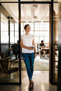 Woman having coffee break at startup