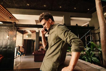 Creative businessman using mobile phone during break