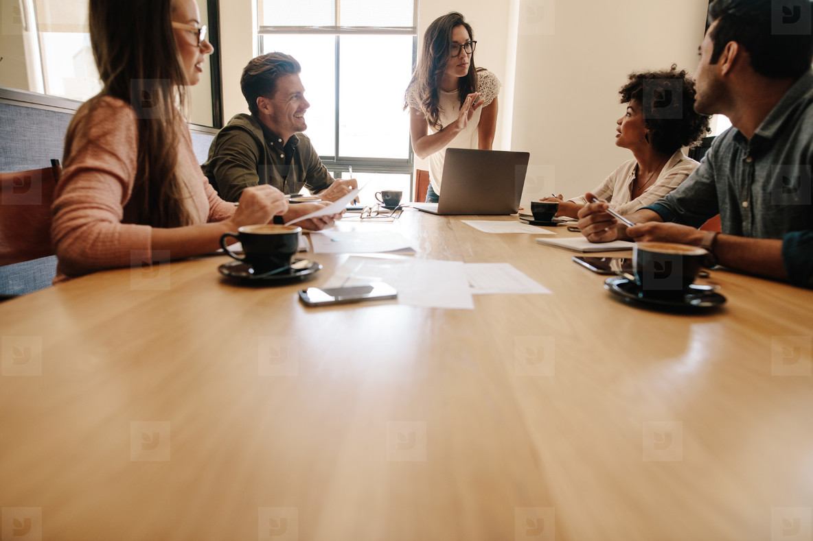 Multi ethnic business team meeting in conference room