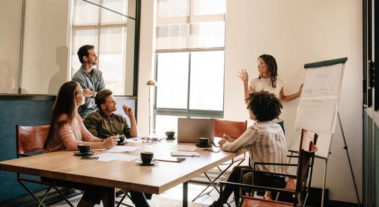 Team meeting in boardroom for exploring new business strategies
