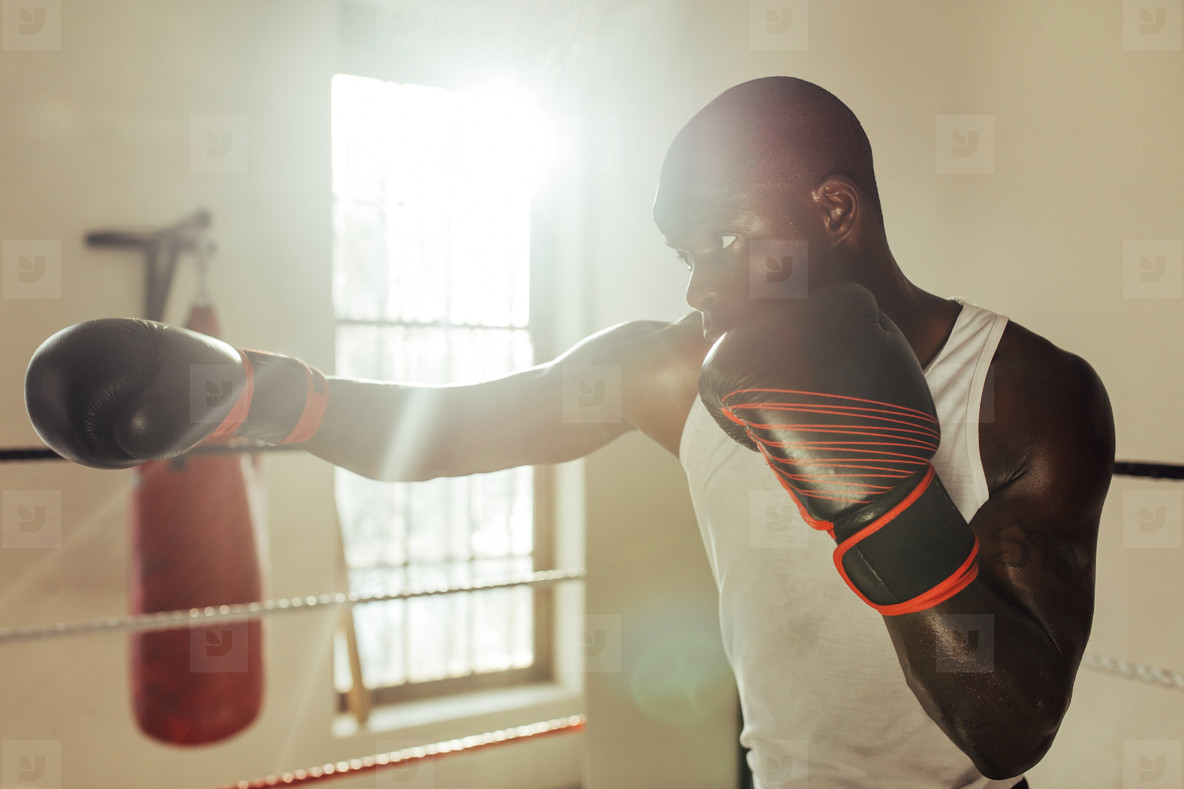 Boxer throwing a jab in gym