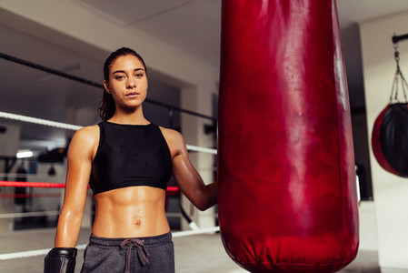 Attractive young fit female boxer in a gym