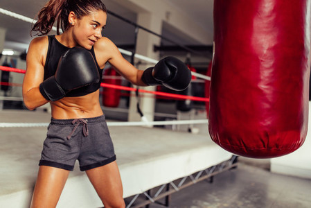 Strong athletic young female boxer