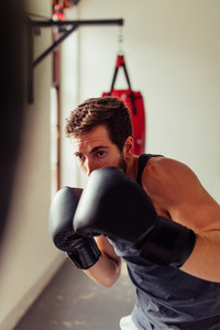 Solitary fighter wearing gloves and black shirt