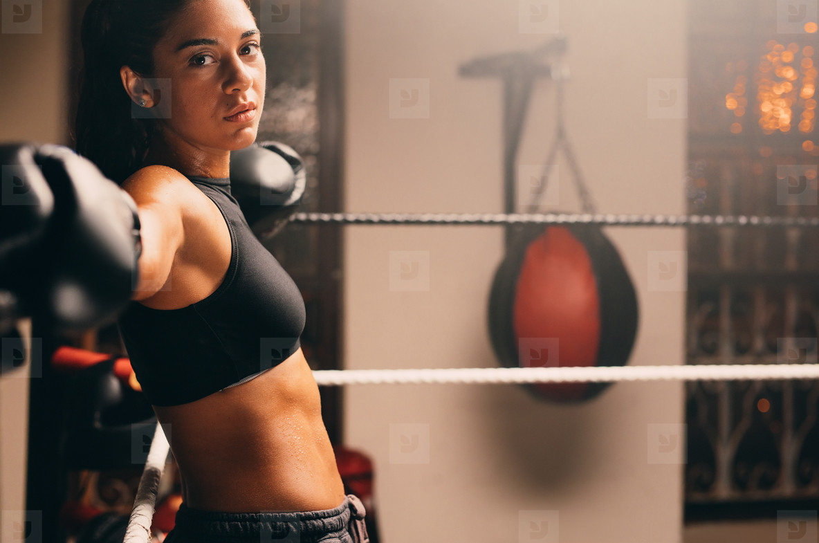 Side profile view of female athlete in boxing gym