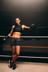 Young woman in darkened workout gym