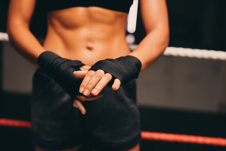 Close up view of female athlete wrapping her hands