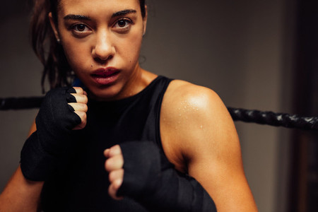 Attractive female martial artist raises her fists